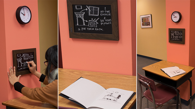 Azisa creating instructional graphics for the third floor excerpt of Understanding (A Classroom), Multimedia Installation, 2014