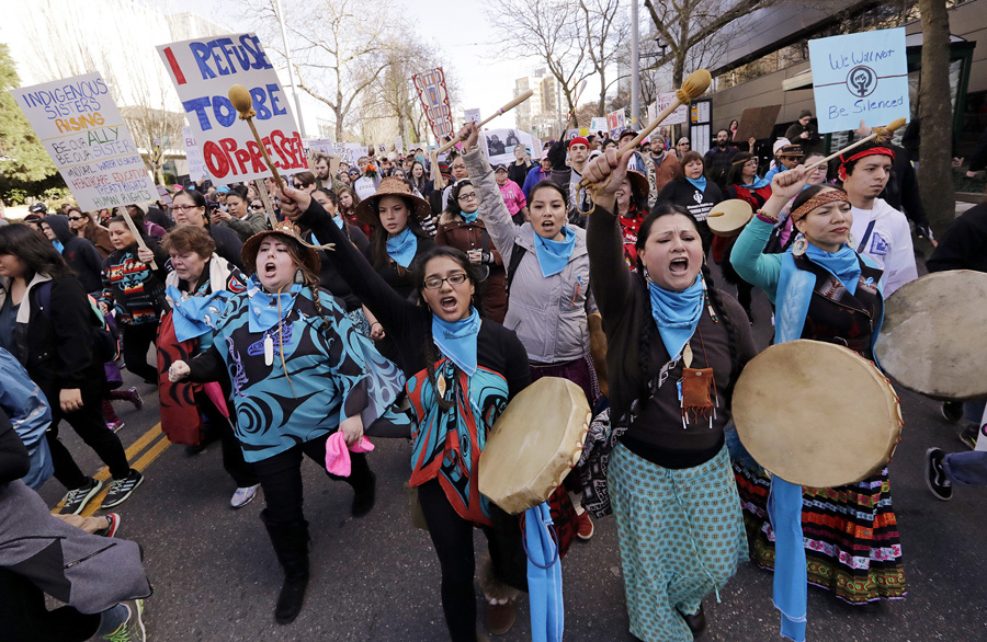 In Seattle, Washington, native American women singers and drummers lead a women's march of thousands as it arrives at the Seattle Center, on January 21, 2017. Women across the Pacific Northwest marched in solidarity with the Women's March on Washington and to send a message in support of women's rights and other causes. Elaine Thompson / AP